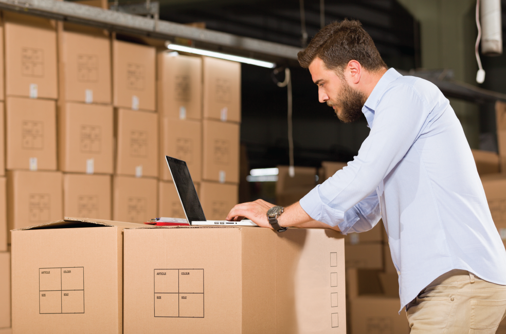 costing for multiple-output production | man at laptop in warehouse